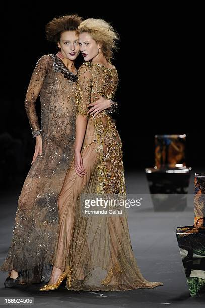 Izabel Hickman and Alicia Kuczman model walks the runway during Lino Villaventura show at Sao Paulo Fashion Week Winter 2014 on October 31 2013 in...