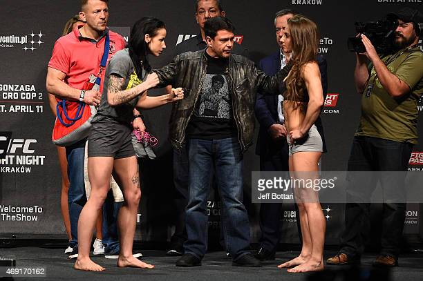 Izabela Badurek and Alexandra Albu face off after weighing in during the UFC Fight Night weighin at the Tauron Arena on April 10 2015 in Krakow Poland