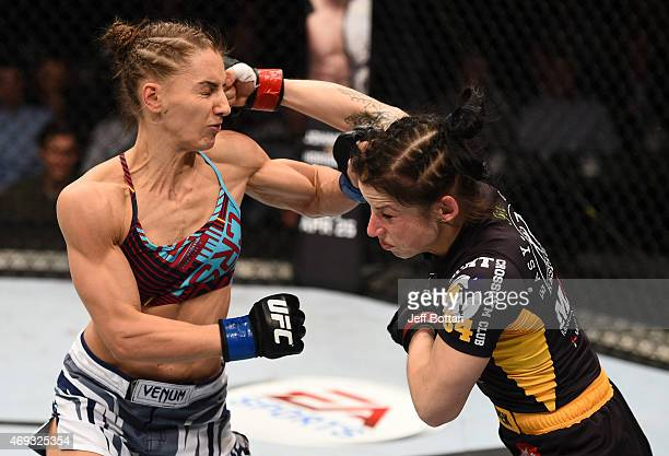 Izabela Badurek of Poland and Alexandra Albu of Russia trade punches in their women's strawweight fight during the UFC Fight Night event at the...