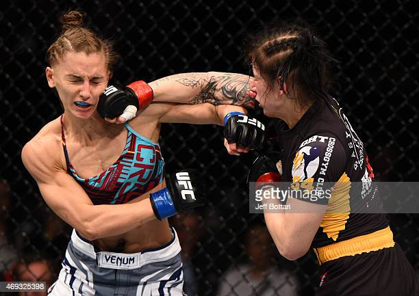 Izabela Badurek of Poland punches Alexandra Albu of Russia in their women's strawweight fight during the UFC Fight Night event at the Tauron Arena on...