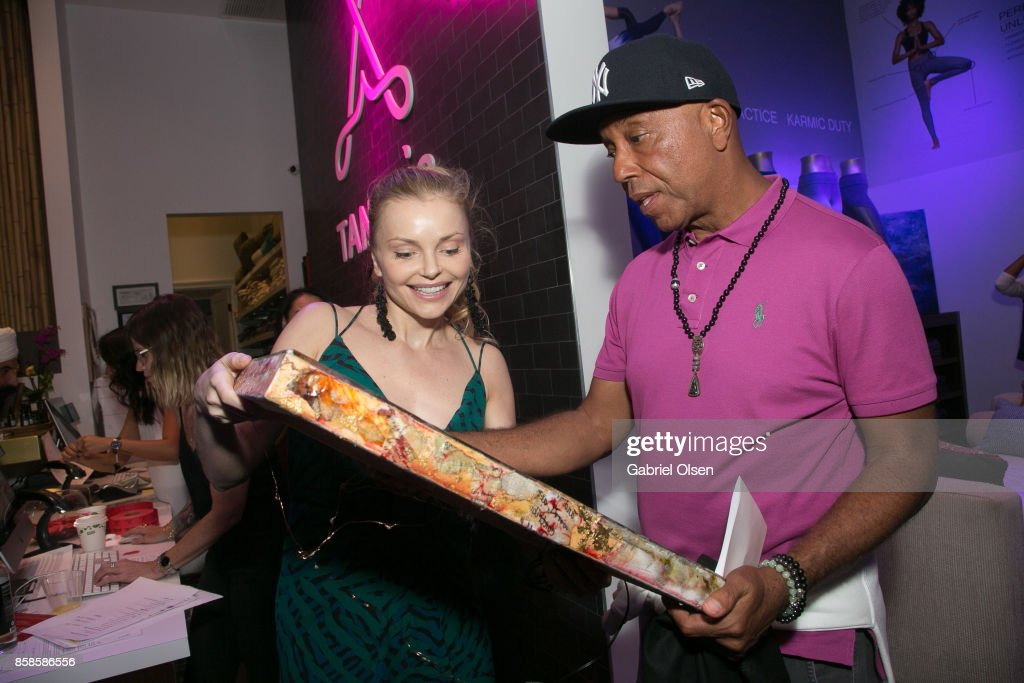 Izabella Miko (L) and Russell Simmons attend his 60th Birthday Party at his Tantris Yoga Center on October 6, 2017 in West Hollywood, California.
