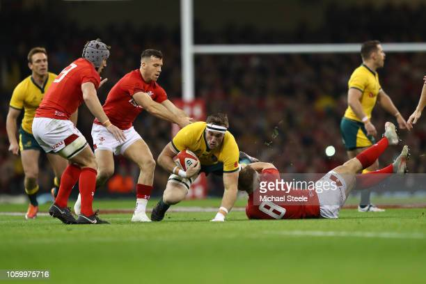 Izack Rodda of Australia is tackled by Ross Moriarty of Wales during the International Friendly match between Wales and Australia at Principality...