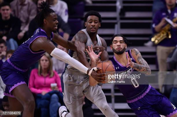 Izaiah Brockington of the Penn State Nittany Lions and Boo Buie of the Northwestern Wildcats battle for the basketball in the first half at WelshRyan...
