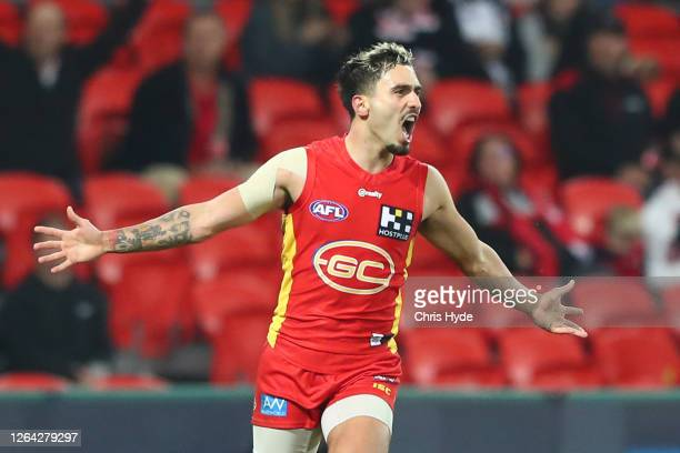 Izak Rankine of the Suns celebrates a goal during the round 10 AFL match between the Gold Coast Suns and the St Kilda Saints at Metricon Stadium on...