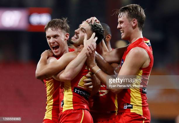Izak Rankine of the Suns celebrates after kicking his first AFL goal during the round 6 AFL match between the Melbourne Demons and the Gold Coast...