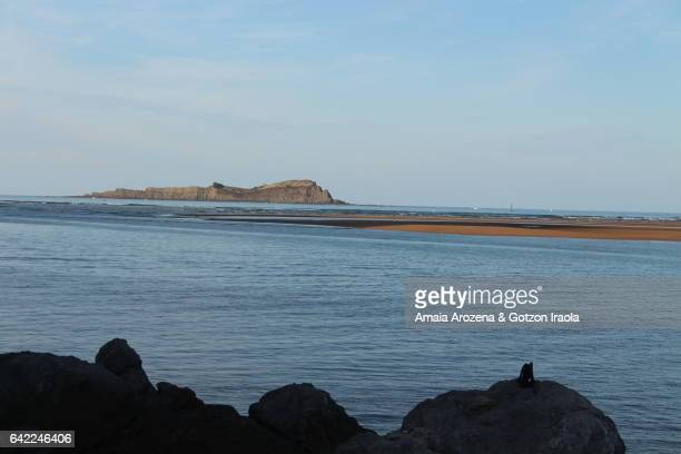 Izaro island from Mundaka town. Biscay province, Basque Country.