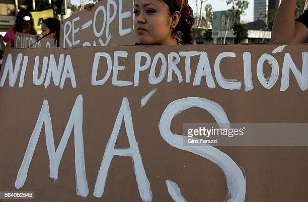 Izel Rojas19 of Placentia protests against a recently approved Costa Mesa measure which would train local police to enforce immigration law in some...