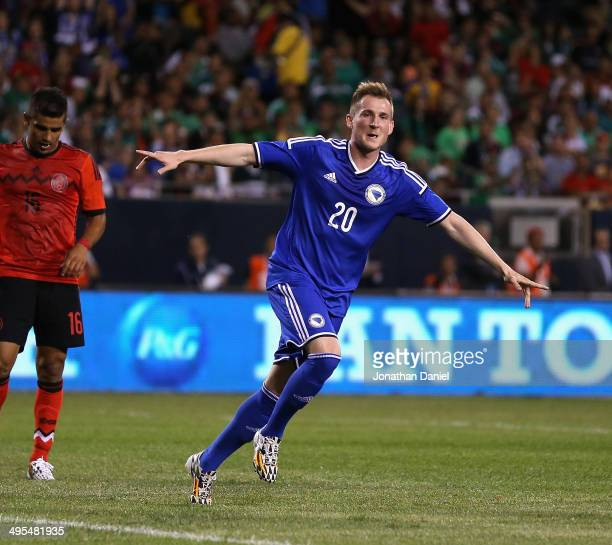 Izet Hajrovic of Bosnia Herzegovina celebrates scoring a first half goal against Mexico during an international friendly match at Soldier Field on...