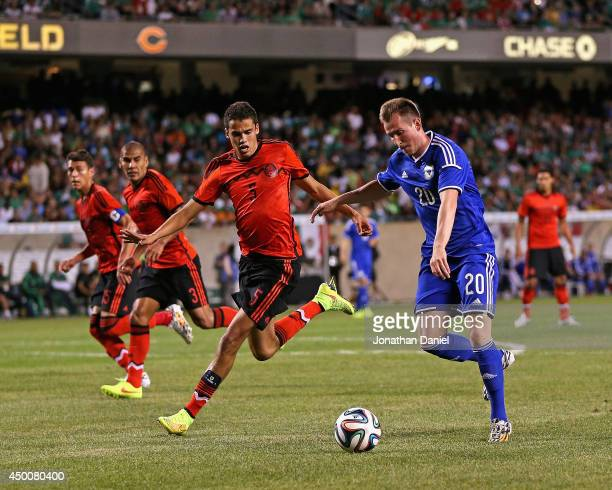 Izet Hajrovic of Bosnia Herzegovina moves against Hector Moreno of Mexico during an international friendly match at Soldier Field on June 3 2014 in...