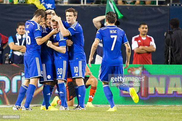 Izet Hajrovic of BosniaHerzegovina celebrates with his teammates after scoring the first goal of the game during the Internatinal friendly match...