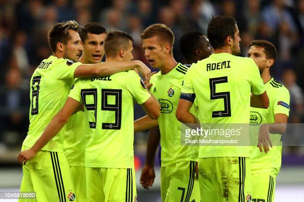Izet Hajrovic of Dinamo Zagreb celebrates with teammates after scoring his team's first goal during the UEFA Europa League Group D match between RSC...