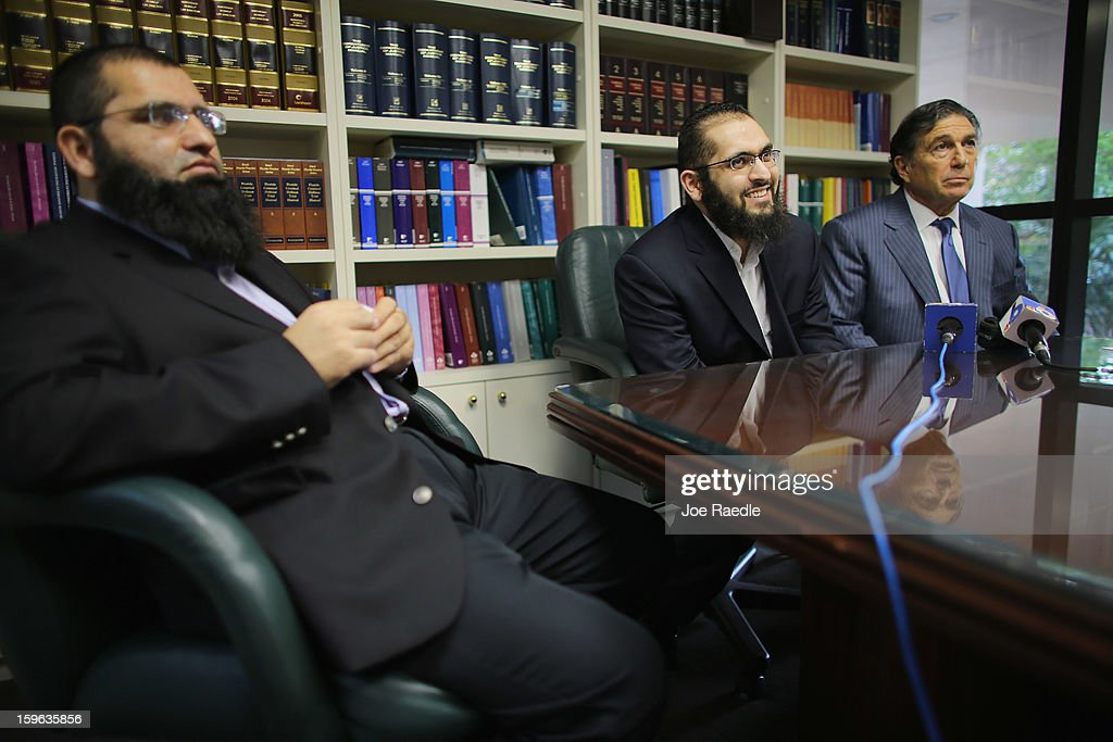 Izhar Khan (C), imam of a Margate, Florida mosque, his lawyer, Joseph Rosenbaum (R), and his brother, Ikram Khan, hold a press conference to discuss a federal judge's decision to throw out the terrorism charges against Izhar on January 17, 2013 in Miami, Florida. Izhar Khan and his father, a Miami imam, who were arrested in May 2011, stood accused of providing financial support to the Pakistani Taliban terrorist organization.