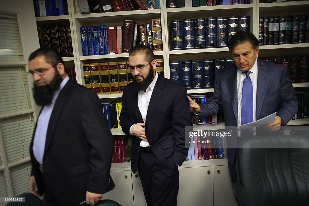 Izhar Khan (C), imam of a Margate, Florida mosque, his lawyer, Joseph Rosenbaum (R), and his brother, Ikram Khan, walk together after holding a press conference to discuss a federal judge's decision to throw out the terrorism charges against Izhar on January 17, 2013 in Miami, Florida. Izhar Khan and his father, a Miami imam, who were arrested in May 2011, stood accused of providing financial support to the Pakistani Taliban terrorist organization.