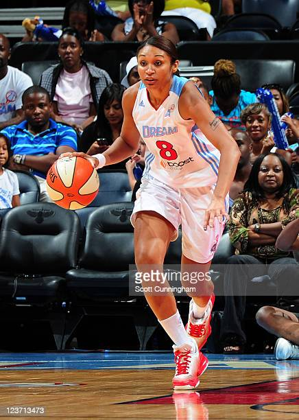 Iziane Castro Marques of the Atlanta Dream drives against the Tulsa Shock at Philips Arena on September 4 2011 in Atlanta Georgia NOTE TO USER User...
