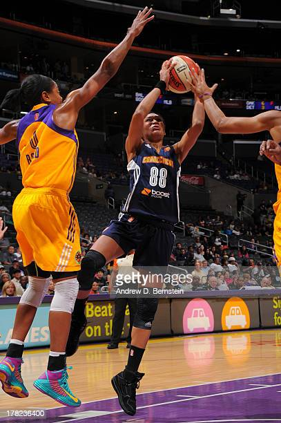 Iziane Castro Marques of the Connecticut Sun attempts a shot during a game against the Los Angeles Sparks at STAPLES Center on August 27 2013 in Los...