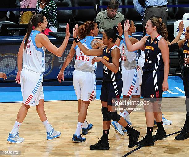 Iziane Castro Marques of the Connecticut Sun congratulates Ruth Riley of the Atlanta Dream after the game at Philips Arena on August 16 2013 in...