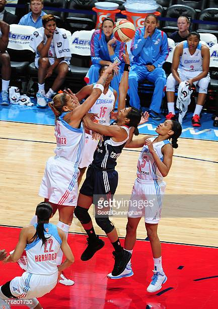 Iziane Castro Marques of the Connecticut Sun puts up a shot against Erika deSouza of the Atlanta Dream at Philips Arena on August 16 2013 in Atlanta...