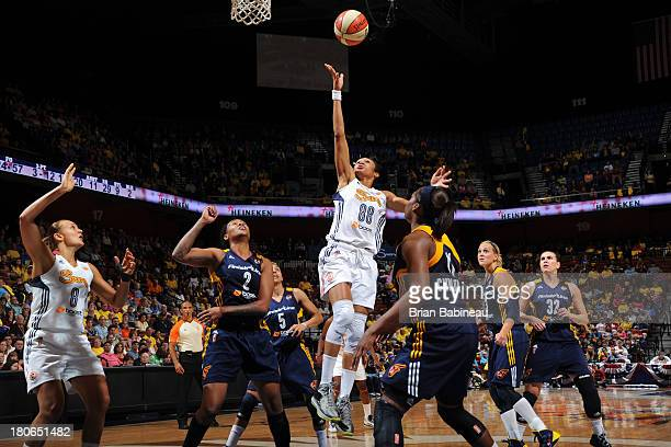 Iziane Castro Marques of the Connecticut Sun takes a shot against the Indiana Fever on September 15 2013 at the Mohegan Sun in Uncasville Connecticut...