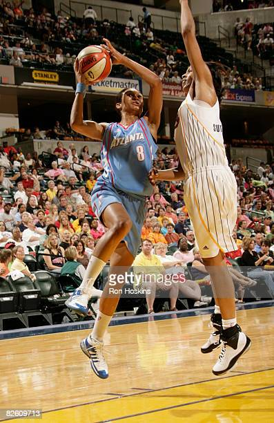 Iziane CastroMarques of the Atlanta Dream shoots over Tammy SuttonBrown of the Indiana Fever at Conseco Fieldhouse on August 30 2008 in Indianapolis...