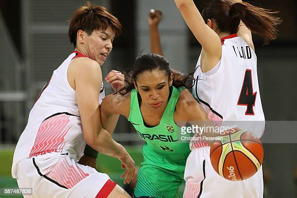 Iziane Marques of Brazil attempts to control the ball during the women's basketball game against Japan on Day 3 of the Rio 2016 Olympic Games at the...