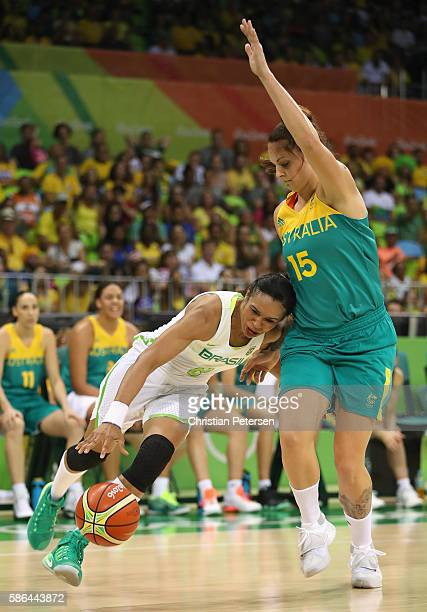 Iziane Marques of Brazil drives the ball against Cayla George of Australia during a Women's Basketball Preliminary Round game on Day 1 of the Rio...