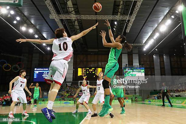 Iziane Marques of Brazil puts up a shot over Ramu Tokashiki of Japan during the women's basketball game on Day 3 of the Rio 2016 Olympic Games at the...
