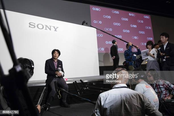 Izumi Kawanishi senior general manager of the AI Robotics Business Group at Sony Corp holds one of the the company's new robotic dogs which the...