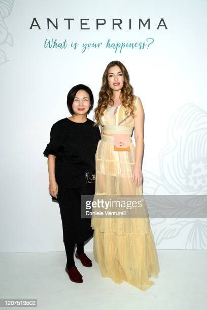 Izumi Ogino and Nilufar Addati pose for the photographer during the backstage of the Anteprima FW20 Milan Show on February 20 2020 in Milan Italy