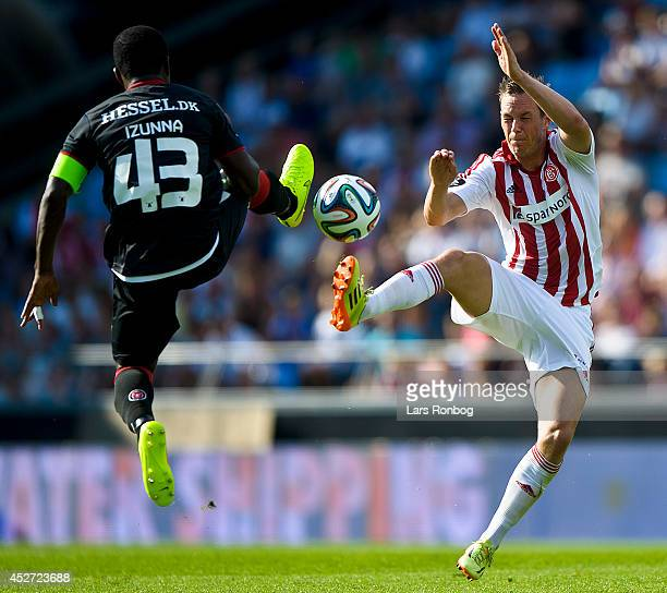 Izunna Uzochukwu of FC Midtjylland and Thomas Enevoldsen of AaB Aalborg compete for the ball during the Danish Superliga match between AaB Aalborg...