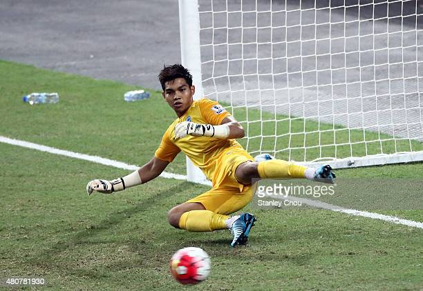 Izwan Mahbud of Singapore is beaten by Chuba Akporn of Arsenal during the Barclays Asia Trophy match between Arsenal and Singapore at National...