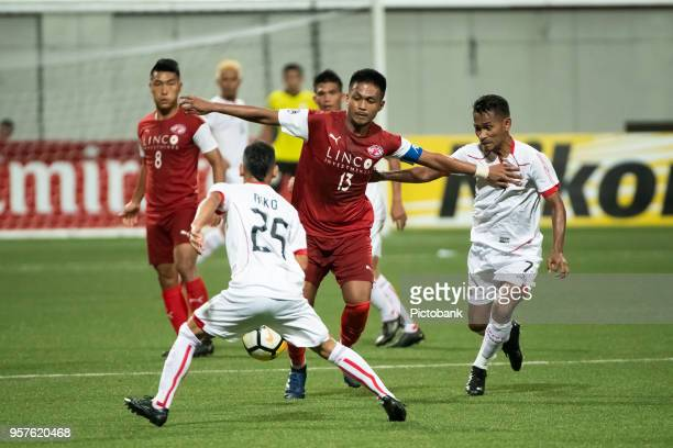 Izzdin Shafiq of Home United shields the ball from Ramdani Lestaluhu and Riko Simanjuntak of Persija Jakarta during the AFC Cup Zonal Semi final...