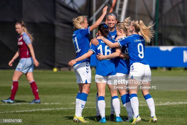 Izzy Christiansen of Everton celebrates scoring her teams second goal with team mates during the Barclays FA Women's Super League match between...