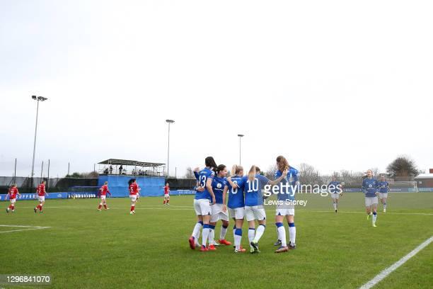 Izzy Christiansen of Everton celebrates with teammates Abbey-Leigh Stringer, Maeva Clemaron, Simone Magill and Nicoline Soerensen after scoring their...