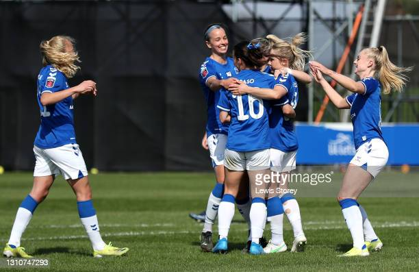 Izzy Christiansen of Everton celebrates with teammates after scoring their team's second goal during the Barclays FA Women's Super League match...