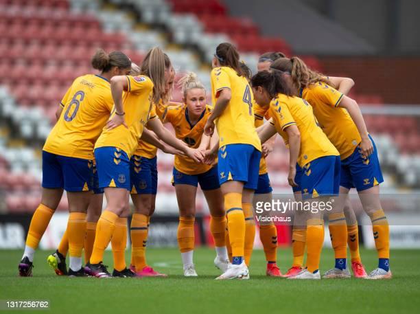 Izzy Christiansen of Everton leads a team huddle with team mates Sandy MacIver, Gabrielle George, Megan Finnigan, Rikke Sevecke, Ingrid Wold, Jill...