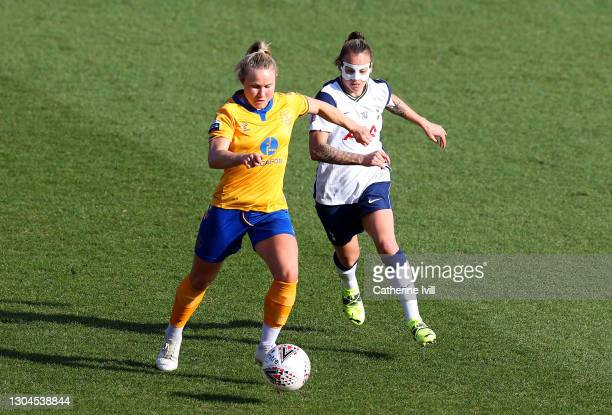 Izzy Christiansen of Everton looks to break past Ria Percival of Tottenham Hotspur during the Barclays FA Women's Super League match between...