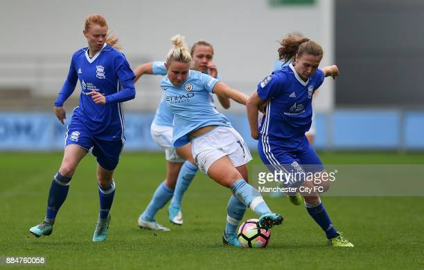 Izzy Christiansen of Manchester City Women controls the ball from Meaghan Sargeant and Charlie Wellings of Birmingham City Ladies during the FA WSL...