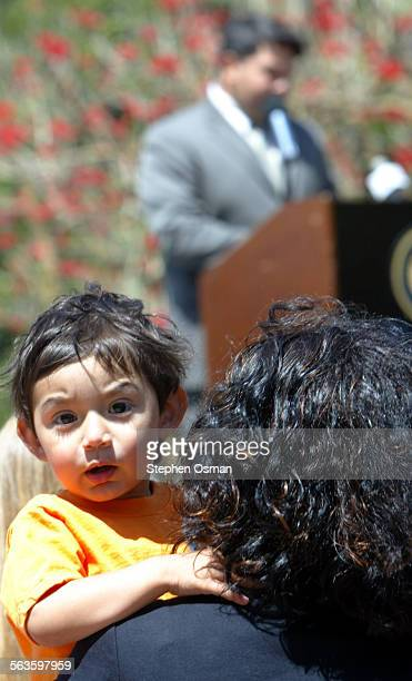 Izzy Jaquez 2 sits on his mother Laura's lap as Oxnard police detective Manuel Vega shares his experience of being abused as a child by a priest Vega...