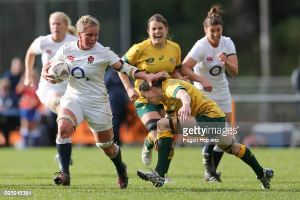 Izzy NoelSmith of England is tackled by Ashleigh Hewson of Australia during the Women's International Test match between the Australian Wallaroos and...