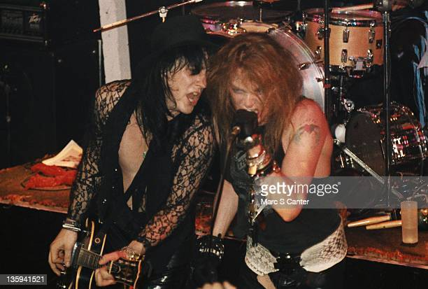 Izzy Stradlin and Axl Rose of the rock band Guns n' Roses performs onstage at the Troubadour where Tom Zutaut of Geffen Records was in the audience...