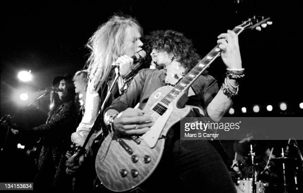 Izzy Stradlin, Duff McKagan, Axl Rose, Slash and Steven Adler of the rock band 'Guns n' Roses' perform at The Music Machine on December 20, 1985 in...