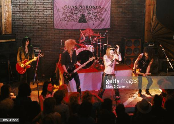 Izzy Stradlin Duff McKagan Steven Adler Axl Rose and Slash of the rock band 'Guns n' Roses' perform onstage at the Troubadour where they played 'My...