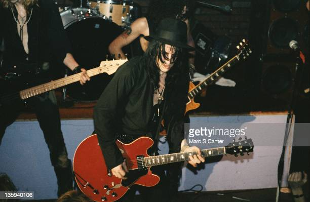 Izzy Stradlin of the rock band Guns n' Roses plays a Gibson hollowbody electric guitar as he performs onstage at the Troubadour on January 4 1986 in...