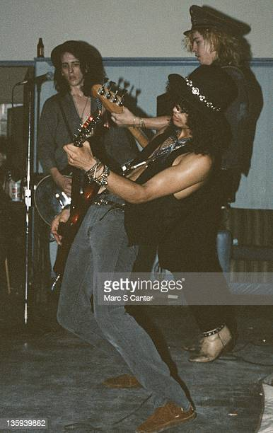 Izzy Stradlin Slash and Duff McKagan of the rock band Guns n' Roses perform onstage at a UCLA frat party where they played Welcome To The Jungle for...