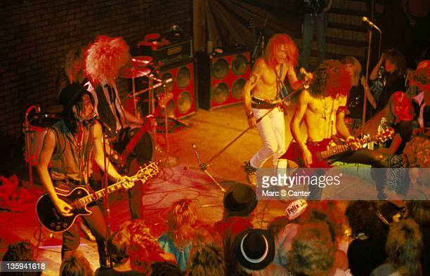 Izzy Stradlin Steven Adler Duff McKagan Axl Rose and Slash of the rock band 'Guns n' Roses' perform onstage at the Troubadour where they played...