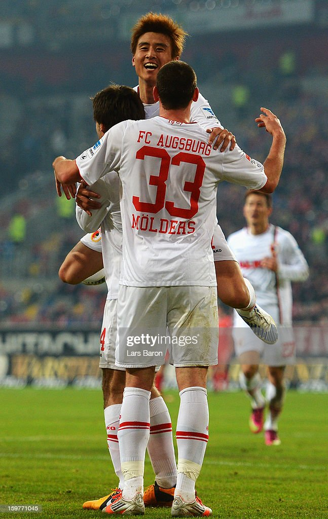 Ja Cheol Koo of Augsburg celebrates with Sascha Moelders, who scored his teams first goal during the Bundesliga match between Fortuna Duesseldorf 1895 and FC Augsburg at Esprit-Arena on January 20, 2013 in Duesseldorf, Germany.