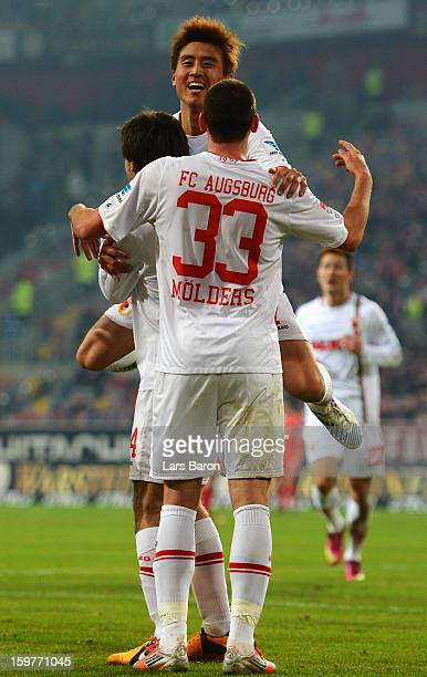 Ja Cheol Koo of Augsburg celebrates with Sascha Moelders who scored his teams first goal during the Bundesliga match between Fortuna Duesseldorf 1895...