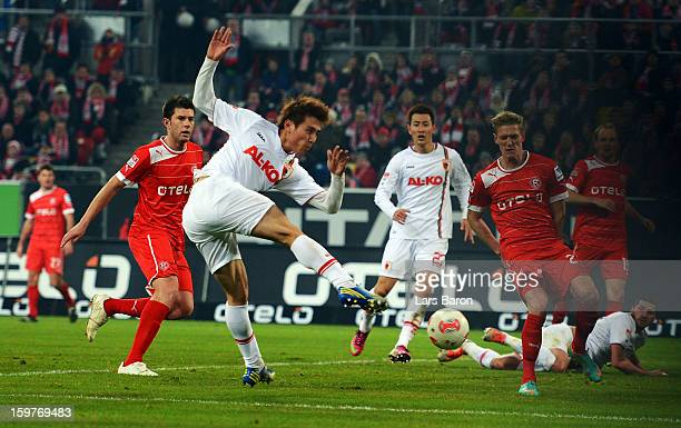 Ja Cheol Koo of Augsburg scores his teams second goal during the Bundesliga match between Fortuna Duesseldorf 1895 and FC Augsburg at EspritArena on...