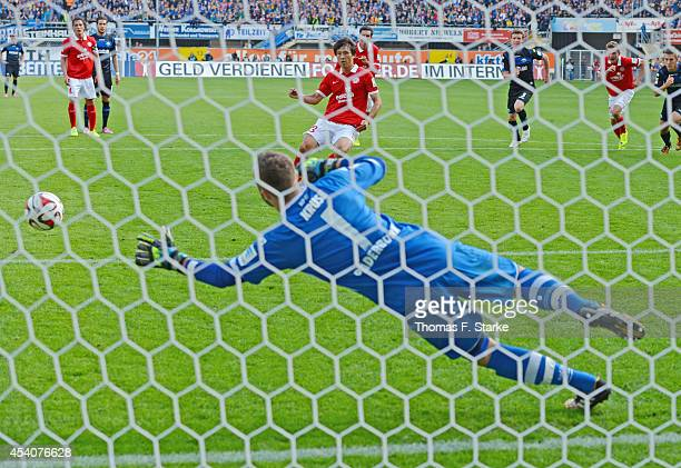 Ja Cheol Koo of Mainz scores a penalty against goalkeeper Lukas Kruse of Paderborn during the Bundesliga match between SC Paderborn and FSV Mainz 05...