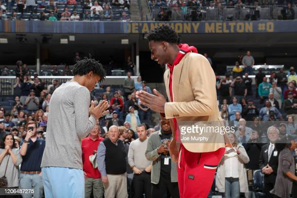 Ja Morant and Jaren Jackson Jr #13 of the Memphis Grizzlies talk to each other during the game against the Orlando Magic on March 10 2020 at...